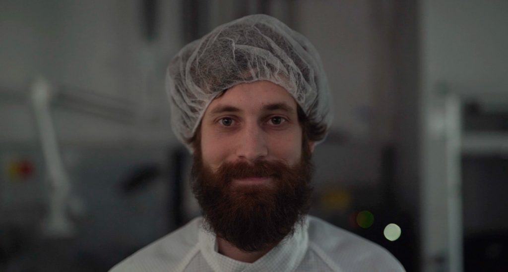 Bartels Mikrotechnik employee with head covering microtechnology microfluidics micropump