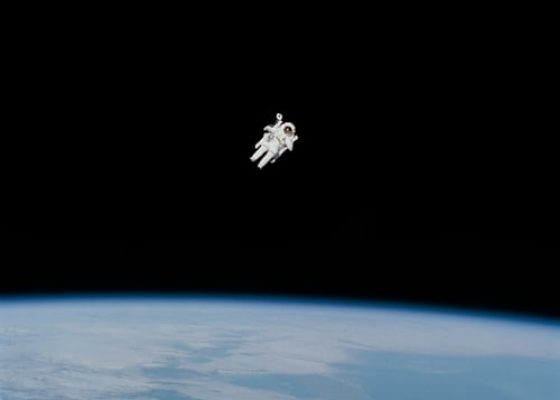 Image from unsplash showing an astronaut in space with the earth at the bottom as example for use of mp6 micropump from Bartels Mikrotechnik